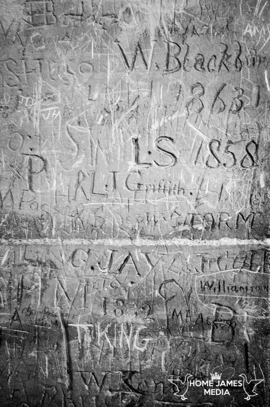 Graffiti carved into stonework in tattershall castle