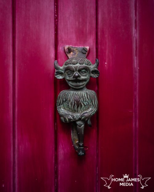 Lincoln Imp Door Knocker on a red door